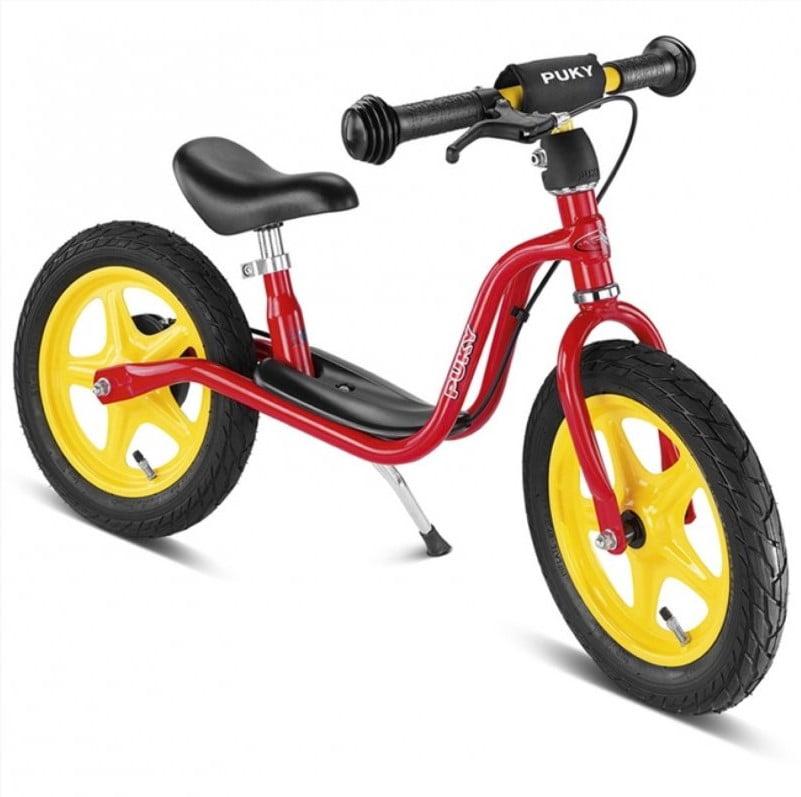 rød, gul og sort børne løbecykel