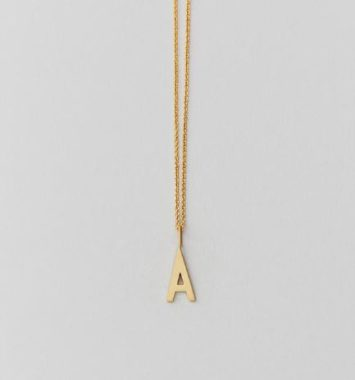 design letters halskaede guld